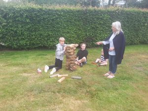 Picture of people doing giant Jenga on the grass